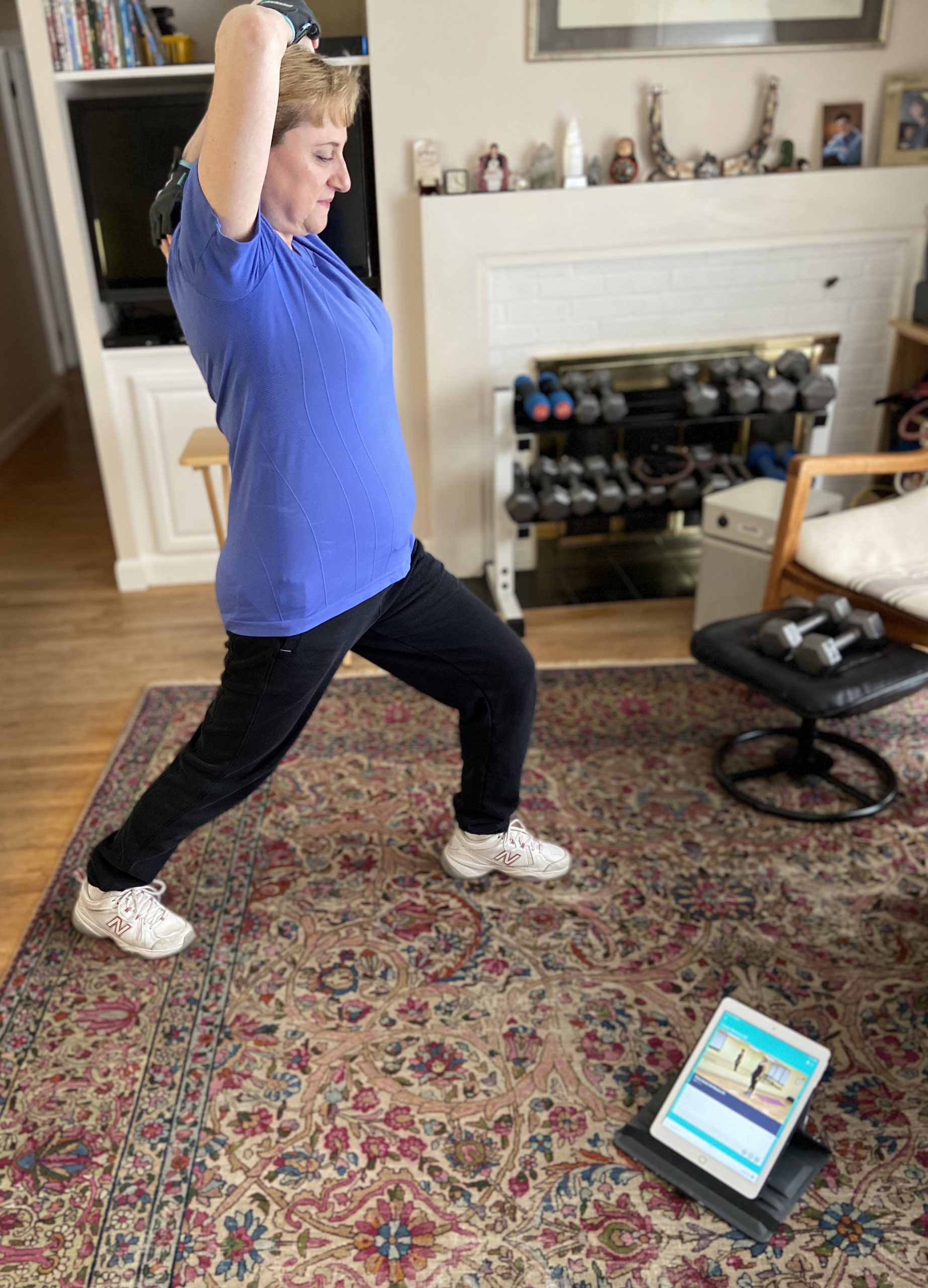 Photo of a woman using the Fitting Fitness In At Home programs to exercise at home