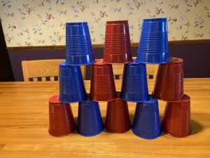 Photo of blue and red solo cups, stacked on top of each other