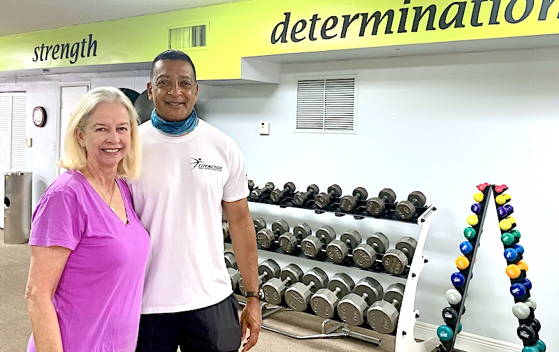 Image of Pat Harlow and her trainer at the gym.