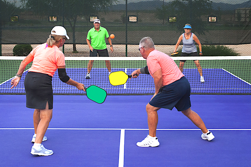 Image of group of older people playing pickleball
