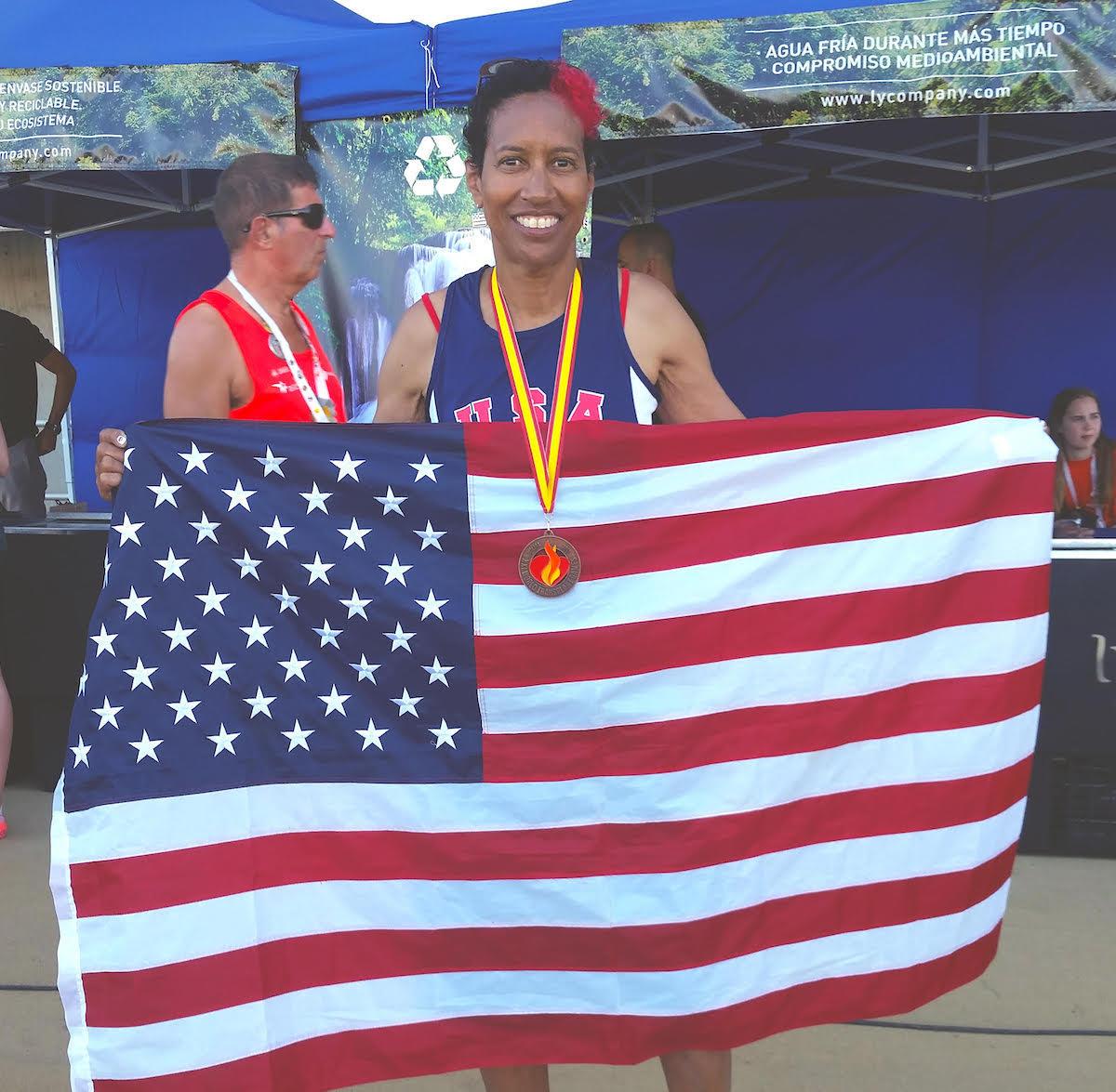 Image of Yvette holding flag.