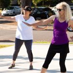 two women doing a fitness dance routine