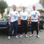 Vince Obsitnik stands with 2 other marathoners, all wearing numbers