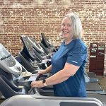 Mary Frances smiles at the camera while on a treadmill